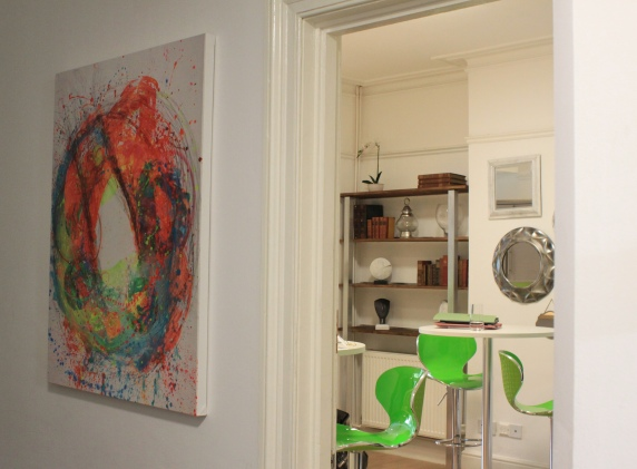 The hallway, looking into the kitchen/dining area. Foreground artwork is by Kate Green