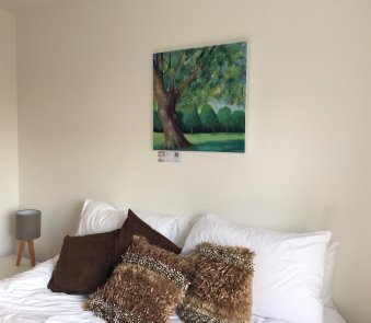 The Master Bedroom, with painting of Cambridge's Jesus Green by Alison Litherland